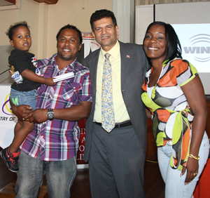 Minister of Transport Chandresh Sharma poses with Vanessa Villafana-Diaz, right, her husband Ramon and their son Malachi at the launch yesterday of the National Road Safety Awareness Campaign, at the Petrotrin Staff Club in Pointe-a-Pierre. Vanessa was the winner of the ministry's Road Safety Slogan Campaign on FaceBook. PHOTO: RISHI RAGOONAT