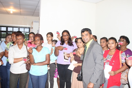 Food assistance card distribution at the Caroni Central Mp Office