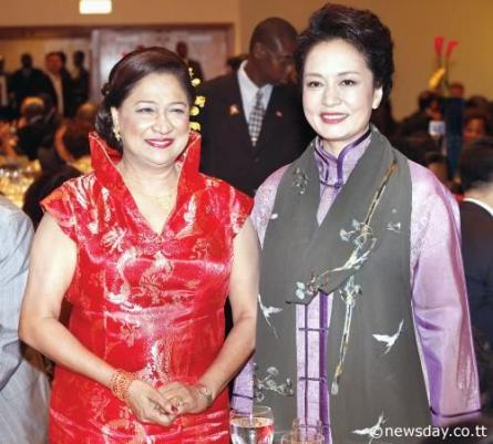 Prime Minister Kamla Persad- Bissessar stands next to China's First Lady Peng Liyuan at lastnight's State banquet hosted by President Anthony Carmona for the visiting Peng and her husband, Xi Jinping, President of The People's Republic of China. The event took place at the Hilton Trinidad.  Author: Azlan Mohammed