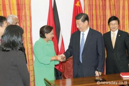 Prime Minister Kamla Persad-Bissessar greets President of China, Xi Jinping at the start of a two-day State visit to Trinidad and Tobago yesterday.  Author: RATTAN JADOO