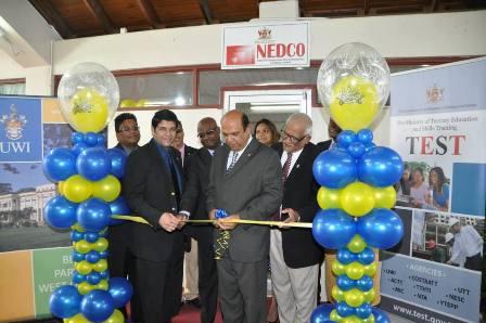 Minister of Tertiary Education and Skills Training, Fazal Karim (centre), NEDCO CEO, Ramlochan Ragoonanan; Permanent Secretary Ministry of Labour and Small and Micro Enterprise Development Mr. Carl Francis (L), and Campus Principal, Clemant Sankat