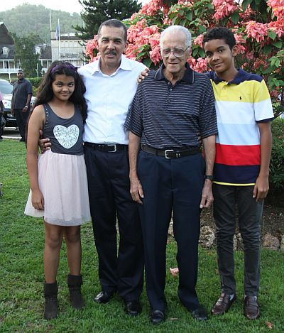 President Anthony Carmona stands proudly with two children, Anura, left and son Christian, looking on is Carmona's father Dennis Stephen Carmona.
