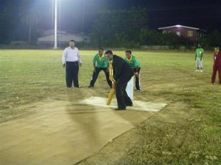 Councillor Allan Seepersad bats under newly installed lights at the Mulchan Seuchan Recreation Ground in Waterloo