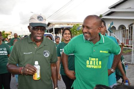 ILP Leader Jack Warner and Mr. Inshan Ishmael on a walkabout for Chaguanas West by-election