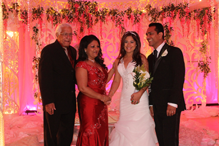 Former Prime Minister and former leader of the United National Congress (UNC)Basdeo Panday, left, and his wife Oma, congratulate UNC activist Ken Emrith, right, and his bride Davica Persad who exchanged marriage vows during a lavish ceremony and reception attended by several government ministers at the Centre of Excellence, Macoya, yesterday. PHOTO:DARREN RAMPERSAD