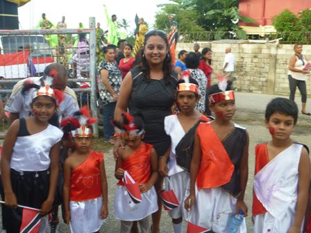 Couva North Member of Parliament, the Honourable Ramona Ramdial (centre) poses with Orange Valley youths who paraded at Independence Day Celebrations on Saturday