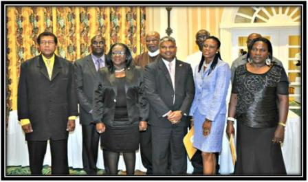Above: The Attorney General poses with appointees at the Tobago function on March 8, 2013.