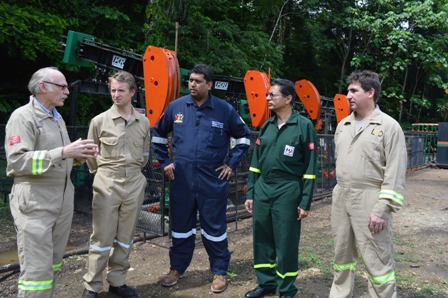 Minister of Energy and Energy Affairs, Senator the Honourable Kevin Ramnarine, centre, has a chat with British High Commissioner His Excellency Arthur Snell, second left, President of Petrotrin Khalid Hassanali, second right,  Leni Oil and Gas Chief Executive Officer Neil Ritson, left,  and Chief Operating Officer Fergus Genkins at the Goudron Oilfield in Guayaguayare.