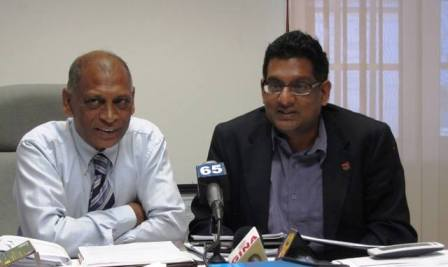 Guyana's Minister of Agriculture Dr. Leslie Ramsammy and Trinidad's Food Production Minister, Devant Maharaj.