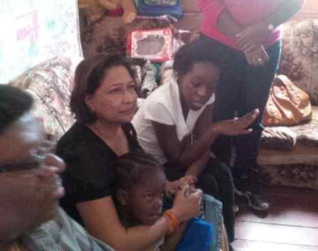 Prime Minister Kamla Persad Bissessar paid a personal visit to the home of Keyana Cumberbatch, where she spoke with Keyana's mother Simone Williams and other relatives. Photo by C-NEWS