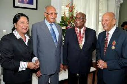 Prime Minister Kamla Persad-Bissessar, His Excellency President George Maxwell Richards, Karl Hudson-Phillips, QC, recipient of the Order of the Republic of Trinidad and Tobago in the sphere of law and Errol Mahabir, recipient of the Chaconia Medal, Gold in the sphere of national service (November 4th 2010)