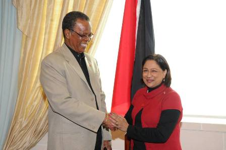Labour Minister Errol Mc Leod welcomes Prime Minister Kamla Persad-Bissessar SC back to Trinidad this morning after visiting her ailing sister in New York. PHOTO COURTESY OFFICE OF THE PRIME MINISTER