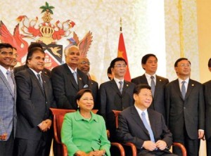 The Prime Minister of Trinidad and Tobago Kamla Persad-Bissessar with Xi Jinping, the president of China.