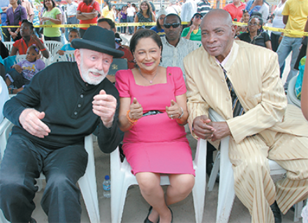 Prime Minister Kamla Persad-Bissessar with veteran masman Peter Minshall, left, and Calypso King of the World Slinger (Mighty Sparrow) Francisco during the Siparia Women's Association's Kiddies Carnival competition at Bhupsingh Park, Penal, yesterday. PHOTO: TONY HOWELL