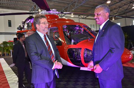 Transport Minister Stephen Cadiz and Couva South MP Rudranath Indarsingh in front of the Sikorsky D76 at yesterday's launch of the new aircraft. Photo: Shastri Boodan. guardian.co.tt