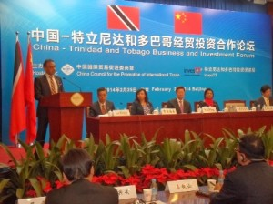 Trade Minister Vasant Bharath addresses the InvesTT forum in Beijing