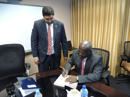"Sir Sam Jonah, Chairman of Range Resources autographs a copy of his book ""Sam Jonah and the remaking of the Ashanti"" for Energy Minister Kevin RamnarineSir Sam Jonah, Chairman of Range Resources autographs a copy of his book ""Sam Jonah and the remaking of the Ashanti"" for Energy Minister Kevin Ramnarine"