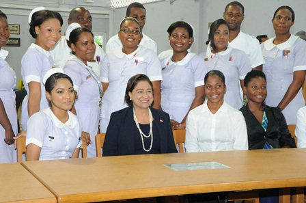 Prime Minister Kamla Persad-Bissessar SC poses with student nurses at the Academy of Nursing and Allied Health in El Dorado this afternoon.