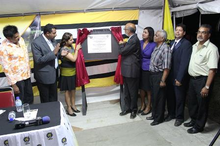 Couva North Member of Parliament, Ramona Ramdial (3rd from left) and Public Utilities Minister, Nizam Baksh (4th from left) unveil the commemorative plaque along with T&TEC officials and stakeholders