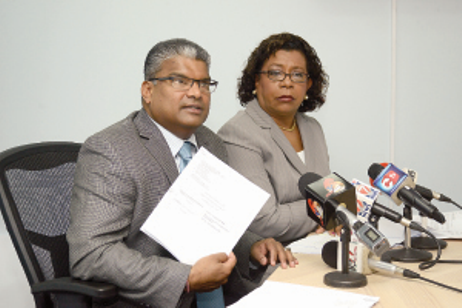 "DOCUMENTS IN HAND: Attorney General Anand Ramlogan shows a certified affidavit from Google Inc, which he claims refutes the validity of the ""Emailgate"" scandal, while Senior Counsel Pamela Elder looks on during a press conference at Ramlogan's office on St Vincent Street, Port of Spain, yesterday. –Photo: ISHMAEL SALANDY"