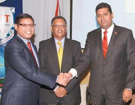 Energy and Energy Affairs Minister Kevin Ramnarine, right, shakes hands with executive director of the Unit Trust Corporation of T&T, Ian Chinapoo. At centre is as executive director of the Planning Ministry's Economic Development Board, Dr Rikhi Permanand. The three men were at yesterday's national release of the Global Competitiveness Report 2014 at the Yara Auditorium, Arthur Lok Jack Graduation School of Business, Mt Hope. PHOTO: SHIRLEY BAHADUR