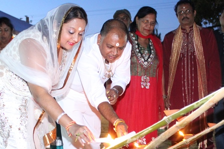 Couva North MP, Ramona Ramdial (2nd from left) and Councillor Dubraj Persad (3rd from left) light the first Diyas at the Couva North Divali Celebration