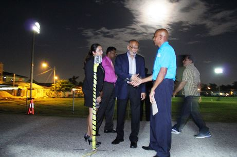 Public Utilities Minister, Nizam Baksh (3rd from left) congratulates Orange Valley Village Council President, Mukesh Babooram as lights on the Orange Valley Recreation Ground are turned on for the fist time
