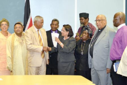 rescue mission: Prime Minister Kamla Persad-Bissessar greets head of the Inter Religious Organisation (IRO) Brother Haripersad Maharaj during a meeting with the organisation at the Prime Minister's Office in Port of Spain yesterday. Looking on are Spiritual Baptist head Barbara Burke, Roman Catholic Archbishop Fr Joseph Harris and at far right, head of the Maha Sabha, Sat Maharaj. —Photo: CURTIS CHASE