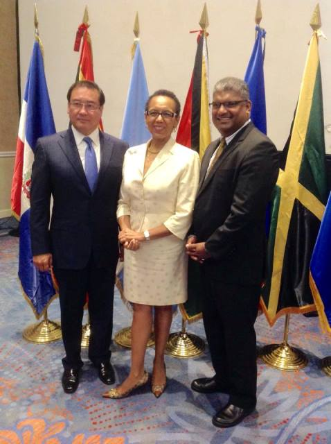In Picture: AG for El Salvador Hon. Luis Antonio Martinez Gonzalez and newly elected Deputy Chair Hon. Anand Ramlogan chat with outgoing Chair AG for the Bahamas Hon. Allison Maynard-Gibson.