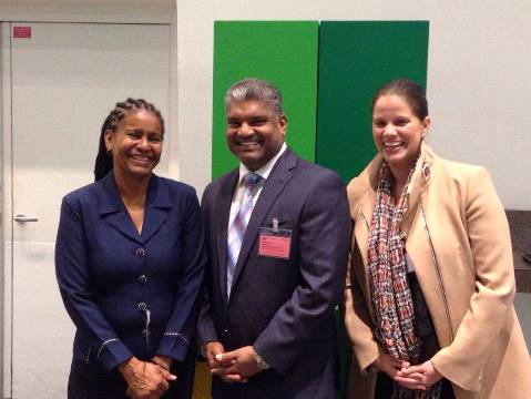 The Deputy Directors of CFATF, Dawn Spicer and Diana Firth greet AG Anand Ramlogan