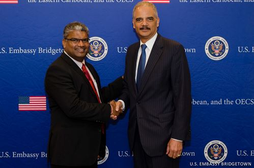 Senator the Honourable Anand Ramlogan SC, Attorney General of Trinidad and Tobago poses with the US Attorney General Eric Holder