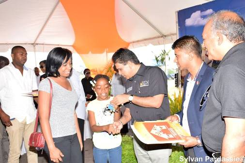 United National Congress » Moonilal hands out HDC keys to 111