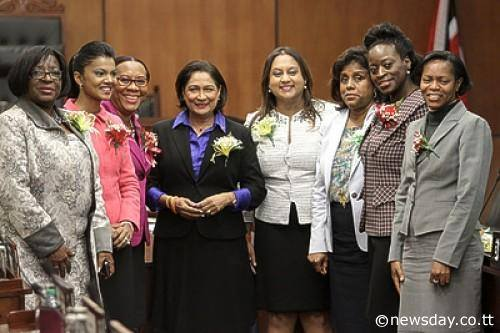 Prime Minister Kamla Persad-Bissessar, centre, along with Government and Opposition MPs, from left, Vernella Alleyne-Toppin, Stacy Roopnarine, Patricia Mc Intosh, Ramona Ramdial, Paula Gopee-Scoon, Donna Cox and Alicia Hospedales set aside politics in Parliament yesterday to celebrate International Women's Day. Author: ROGER JACOB Photo Courtesy: www.newsday.co.tt/