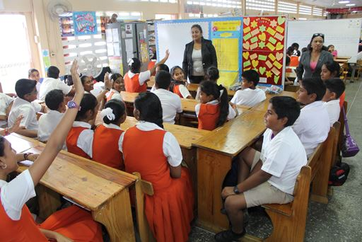 Couva North MP Ramona Ramdial (front left) answers questions from students of the Freeport Hindu Primary School