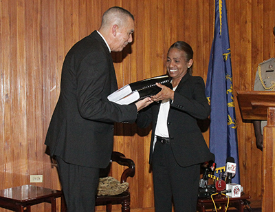 President Anthony Carmona receives the report of the commission of enquiry into Clico from secretary to the commission, Judith Gonzales, at the Office of the President, St Ann's,. PHOTO: NICOLE DRAYTON: GUARDIAN