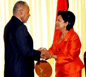 Kamla Persad-Bissessar, SC, MP Leader of the Opposition and the late Patrick Manning