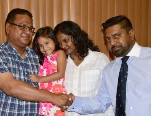 SURGERY IN MAY: Attorney Gerald Ramdeen, right, meets with the Luke family at his law chambers in Woodbrook last week. From left are parents Arthur Luke and Michelle Kallie-Luke holding their four-year-old daughter, Shannen. Image Courtesy: Trinidad Express