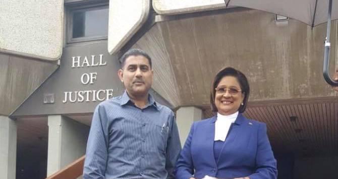 Opposition Leader Kamla Persad-Bissessar, SC, MP retired Police Officer Fazal Ghany