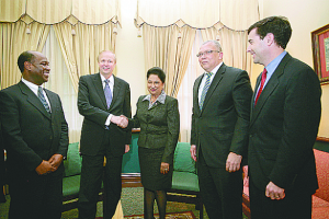 BP CEO Robert Dudley shakes hands with Trinidad and Tobago Prime Minister Kamla Persad-Bissessar at the Parliament building on November 26. Accompanying Dudley are, from left, bpTT chief financial officer and regional president designate Norman Christie, current bpTT CEO Robert Riley and BP vice president, production Robert Fryar. Dec 201p.